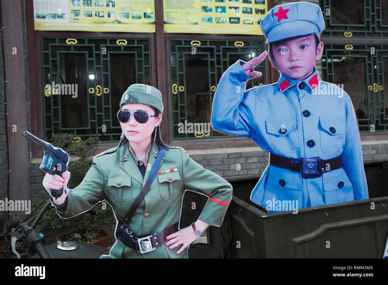 A poster featuring a Kuomintang female official and a child soldier of CCP Red Army in Xiangshan Film Studio in Xiangshan, Zhejiang, China. - Stock Image