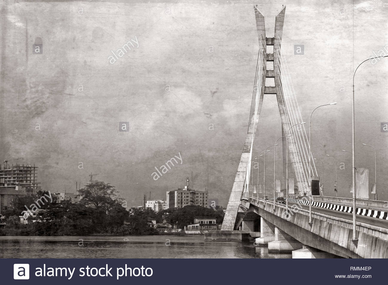 Lekki, Lagos, Nigeria; Lekki bridge shown in black and white, with grunge look - old retro photo effect - Stock Image