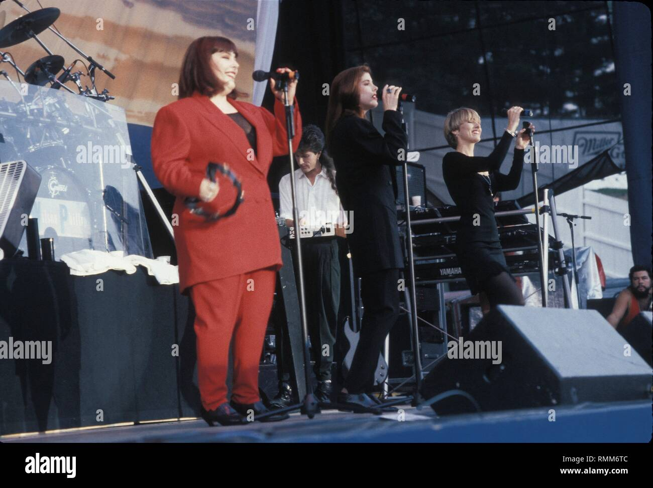 The vocal group Wilson Phillips, consisting of Carnie and Wendy Wilson and Chynna Phillips, is shown performing on stage during a 'live' concert appearance. - Stock Image