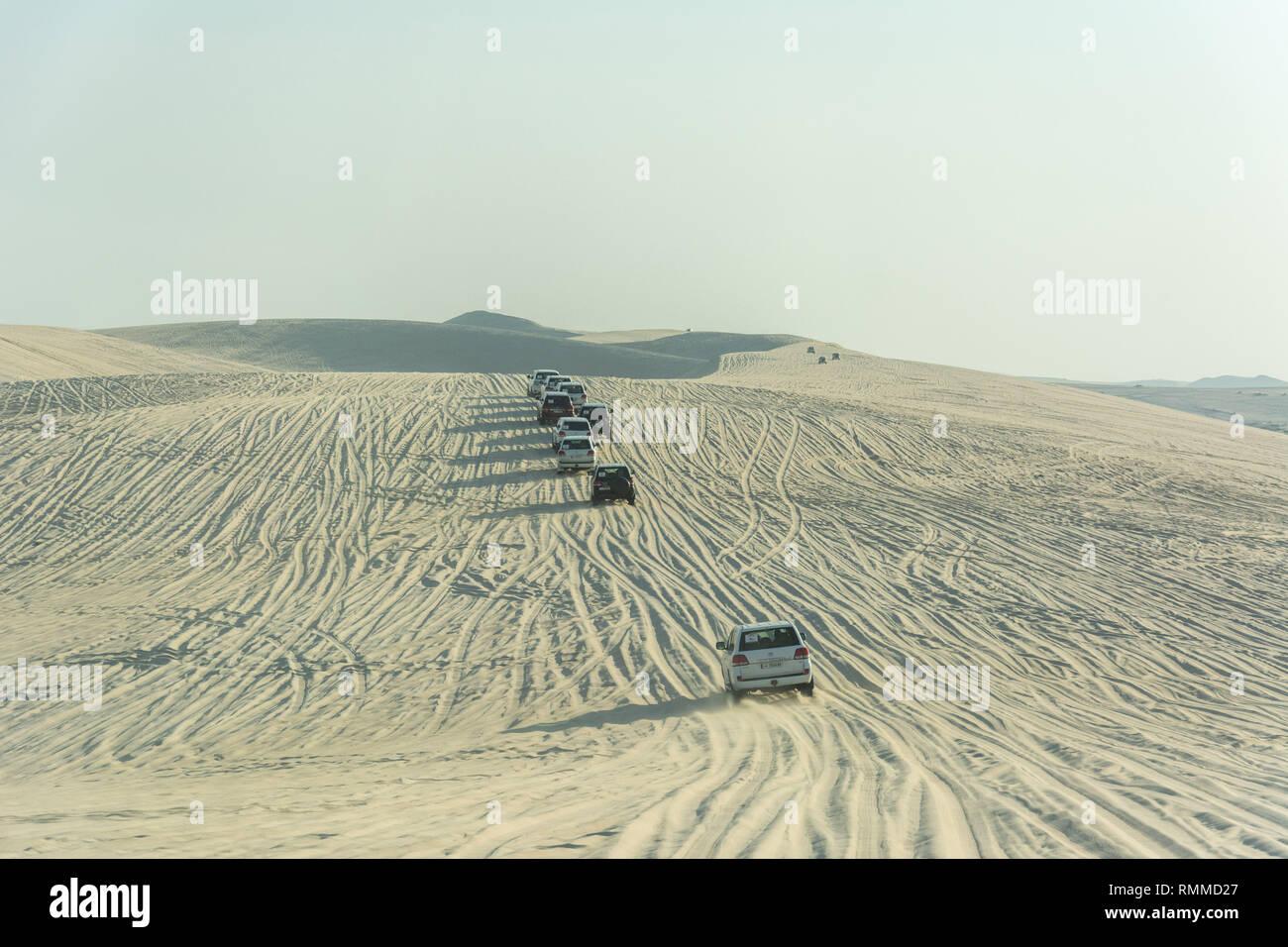 Khor Al Adaid, Qatar - November 5, 2016. 4WD vehicles driving on sand dunes in Khor Al Adaid desert in Qatar. - Stock Image