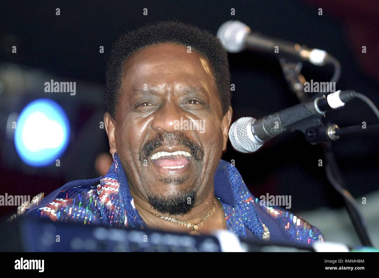 """Musician, bandleader, talent scout, and record producer Ike Turner is shown performing on stage during a """"live"""" concert appearance. Stock Photo"""