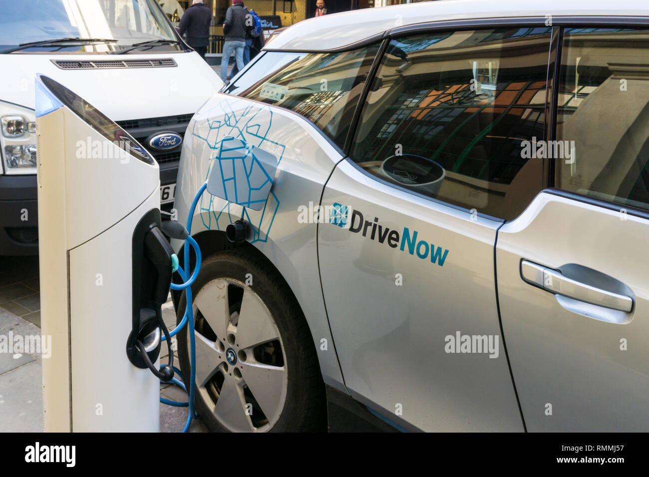 A Drive Now Car Sharing BMW i3 electric car being charged at a charging point in central London. - Stock Image