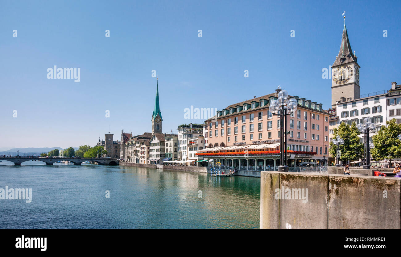 Switzerland, Canton Zürich, view of the Old Town of Zürich from River Limmat with the prominent Storchen Hotel, St. Peter Church and Fraumünster Churc - Stock Image