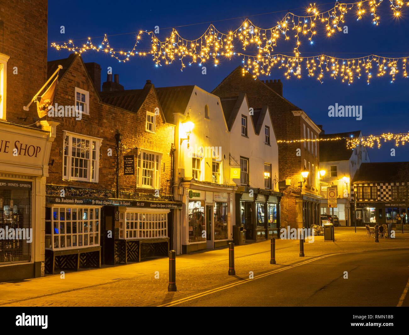 Oldest Chemist Shop in England in the Market Place at dusk Knaresborough North Yorkshire England - Stock Image