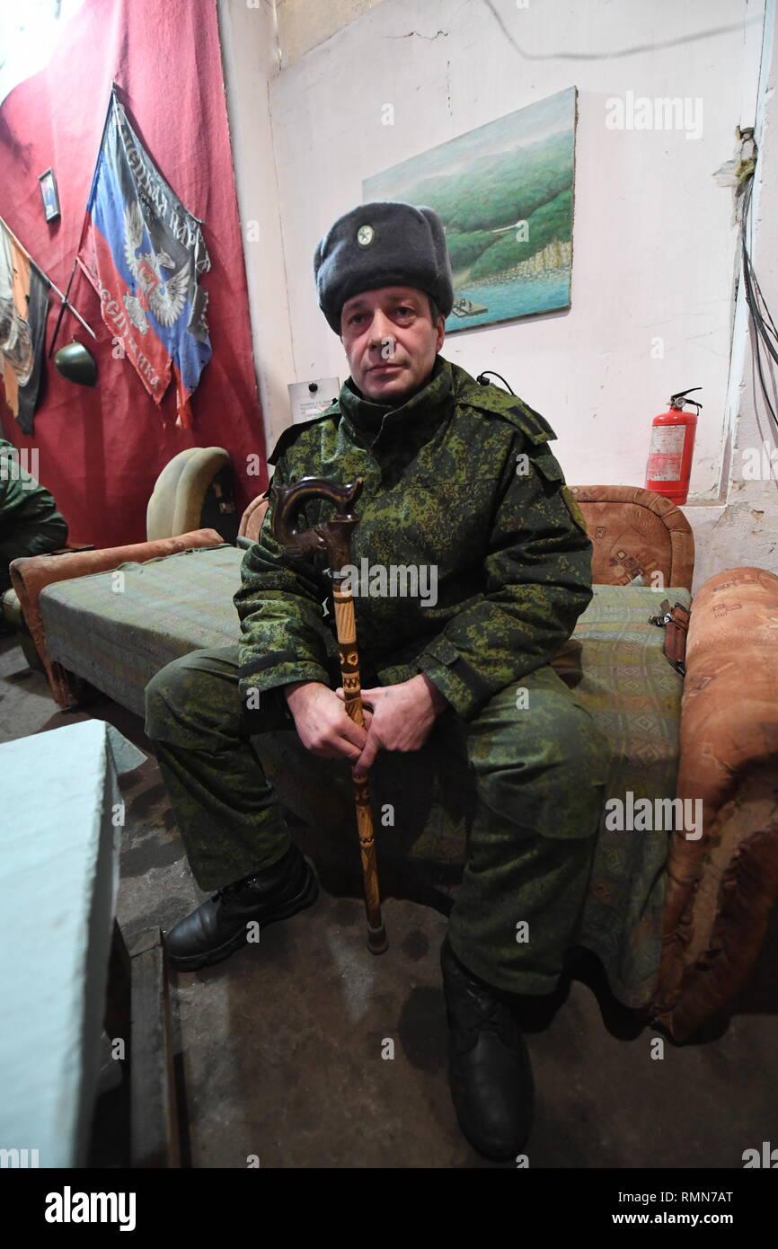 DPR soldier from the Shakhtyorsk division, called name, Arkadiy, seen relaxing between shifts in the division HQ. The war between the Ukrainian army and the soldiers of the Donetsk Peoples Republic has cost the lives of 12,000 people and those who have been displaced exceed a million. It escalated in 2014. Despite a ceasefire in place, it is evident that death still occurs from predominantly, sniper, mortar and mines. The construction of trenches either side of no-man's land, (often only 100mt apart) have ensured a static yet aggressive confrontation. The Minsk ceasefire agreement and constant Stock Photo