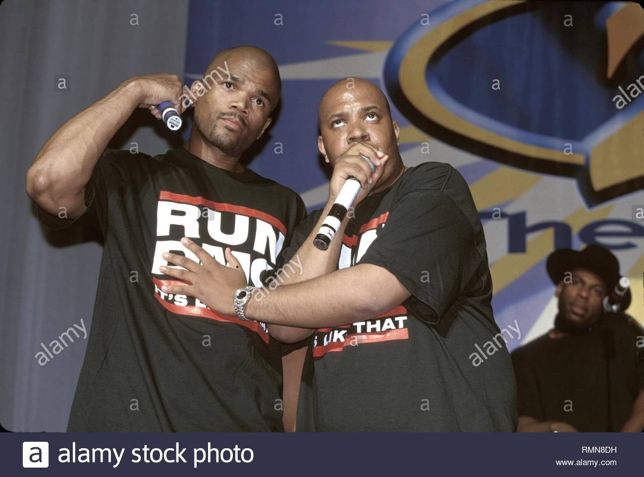 Run DMC.are shown performing on stage during a 'live' concert appearance. - Stock Image