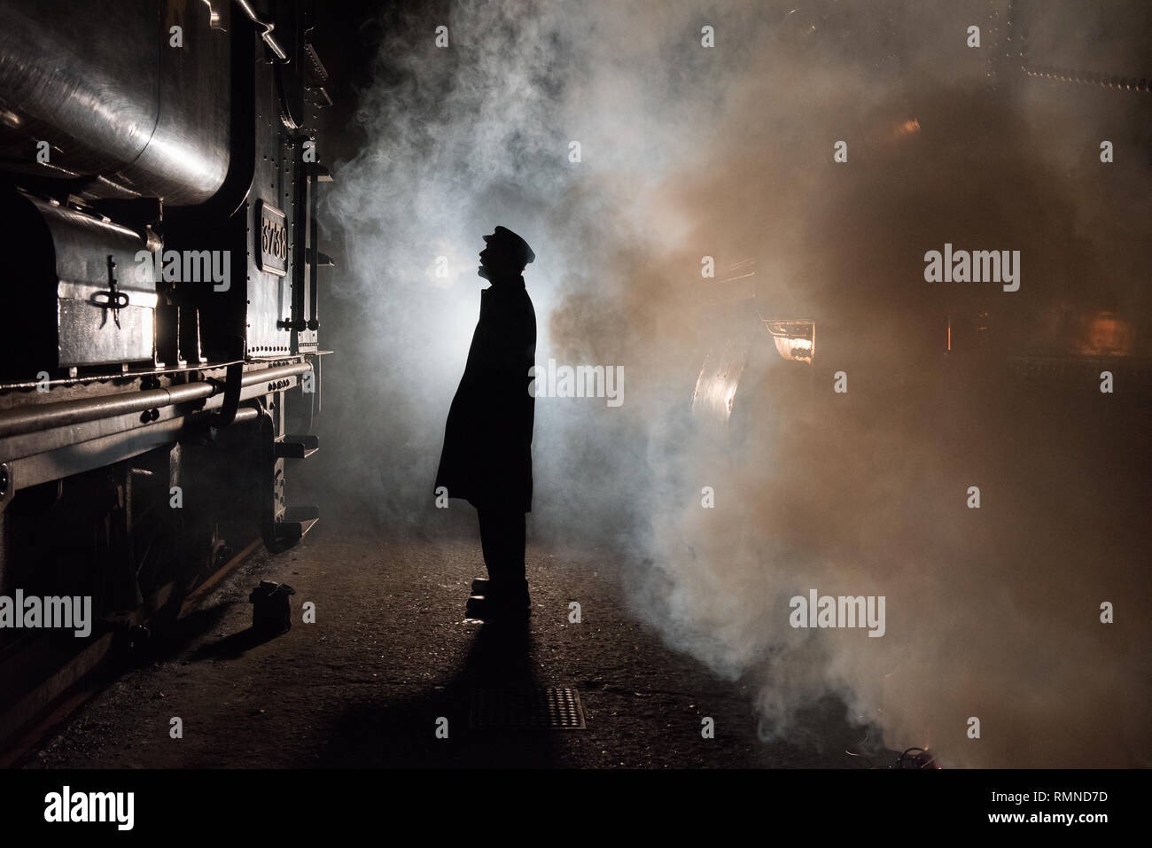 Cold Winter's Evening in a Train Shed - Stock Image