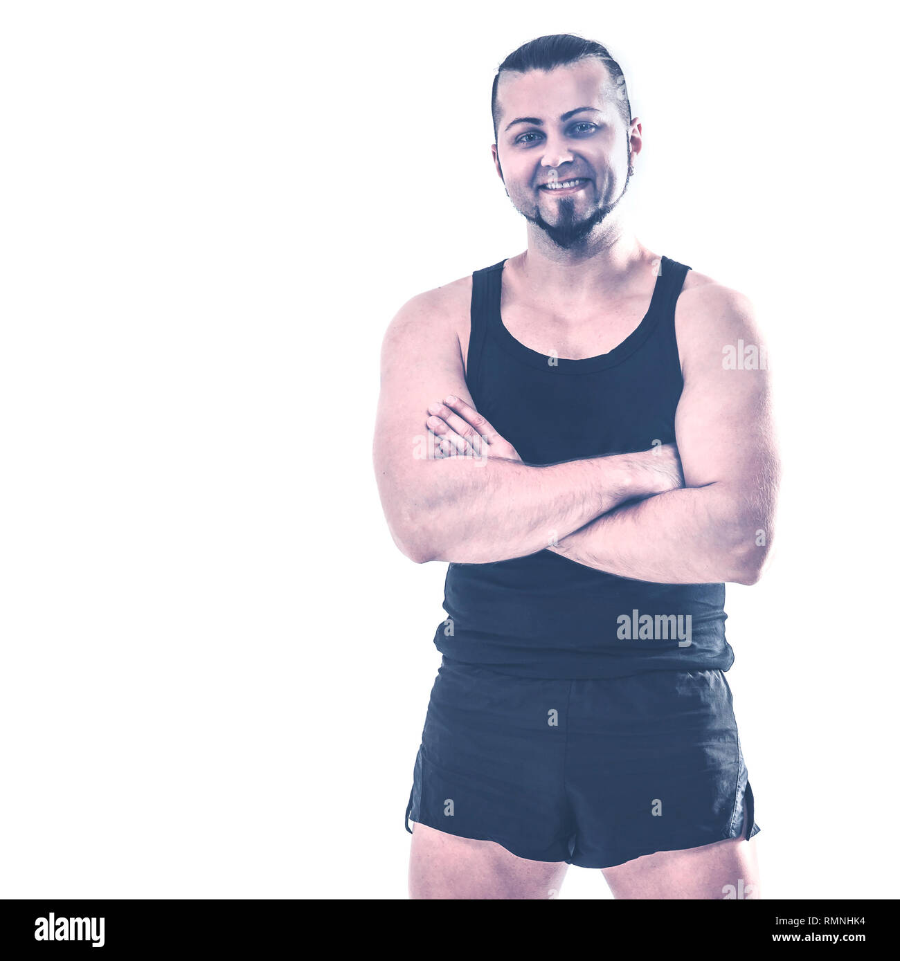 portrait of charismatic trainer on bodybuilding on a light backg Stock Photo