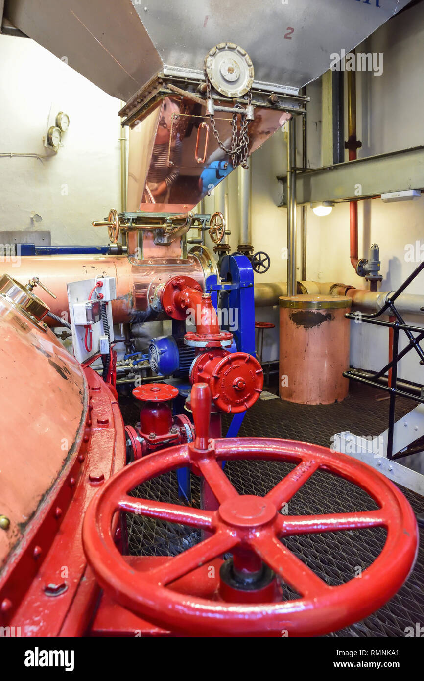 Traditional distillery tanks in Tobermory Distillery, Ledaig, Tobermory, Isle of Bute, Inner Hebrides, Argyll and Bute, Scotland, United Kingdom - Stock Image