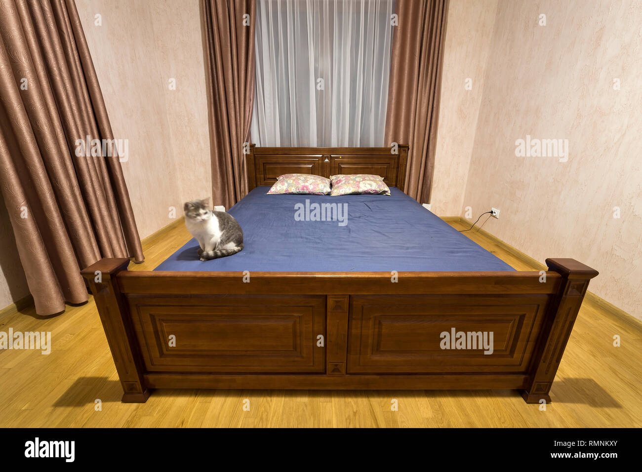 New Spacious Bedroom Interior Design In White And Brown Tone Wooden Floor And Comfortable Double Bed Nice Curtains On Wide Windows Stock Photo Alamy