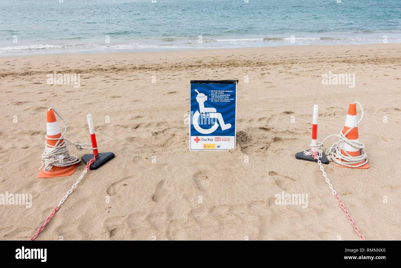 Area of beach in Spain reserved for floating plastic wheelchair access. Wheelchair is supplied by Lifeguard service. - Stock Image