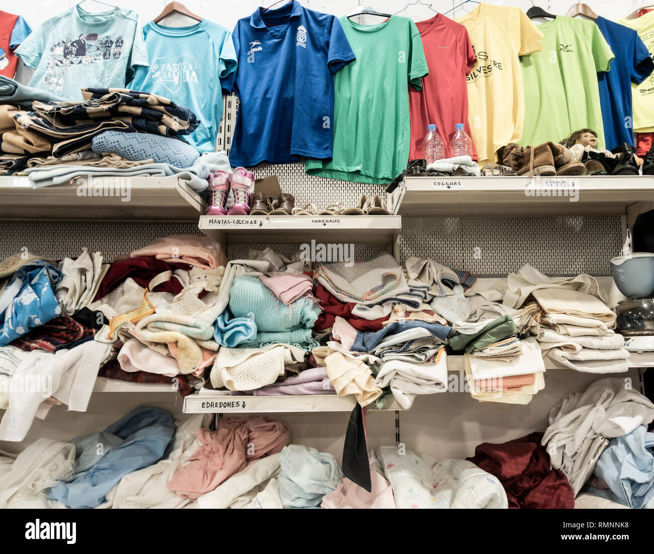 Secondhand clothes in charity shop in Spain - Stock Image
