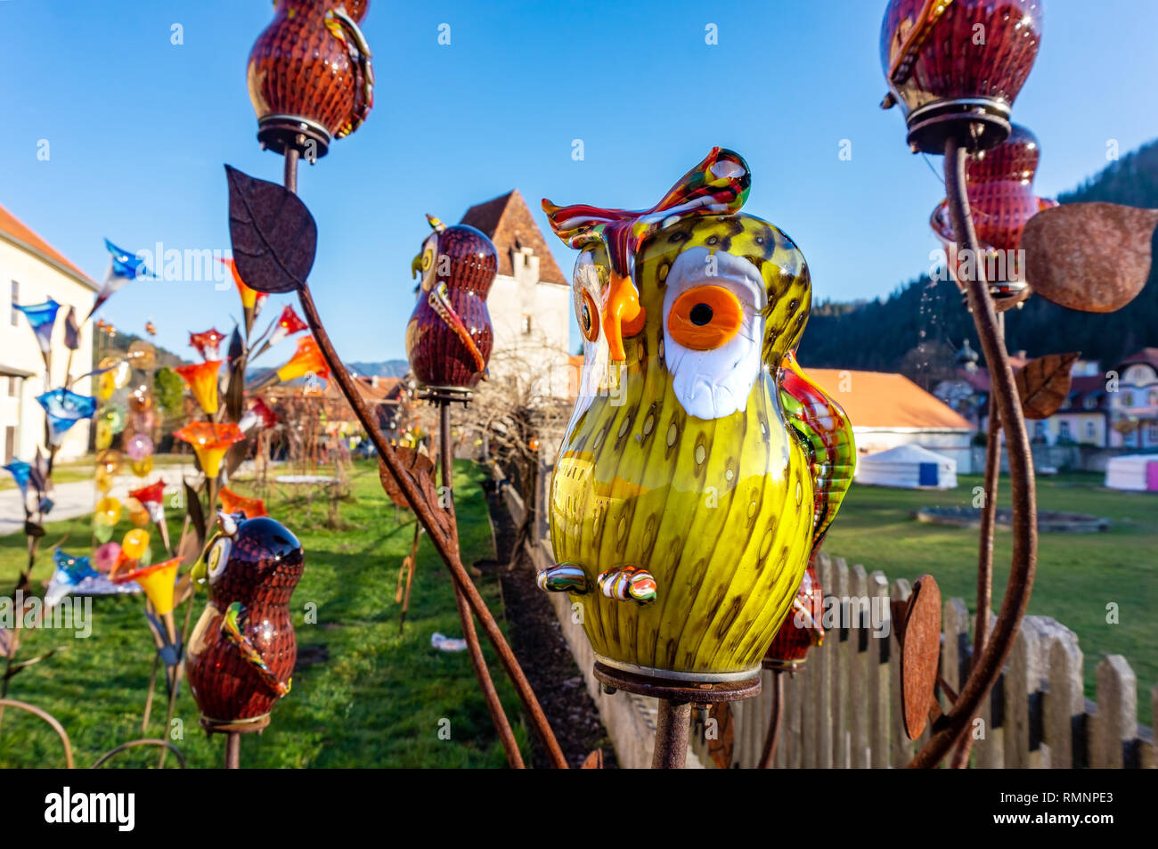 Neuberg an der Murz , Austria - 15.11.2018: Glass manufature Kaiserhof Glass worker manufacture with colorful glassware outside garden glass factory w - Stock Image