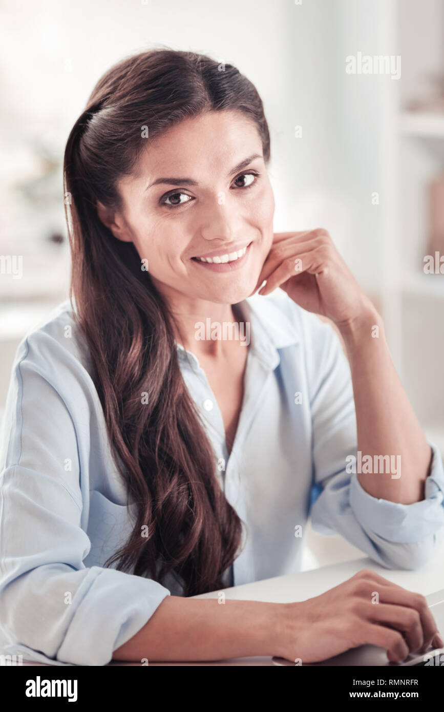 True motivation. Talented businesswoman feeling satisfied and fulfilled after receiving long-awaited promotion at favorite job - Stock Image