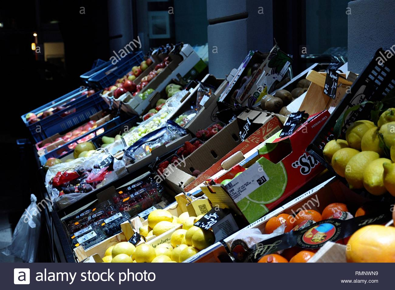 Fruits on market at night - Stock Image