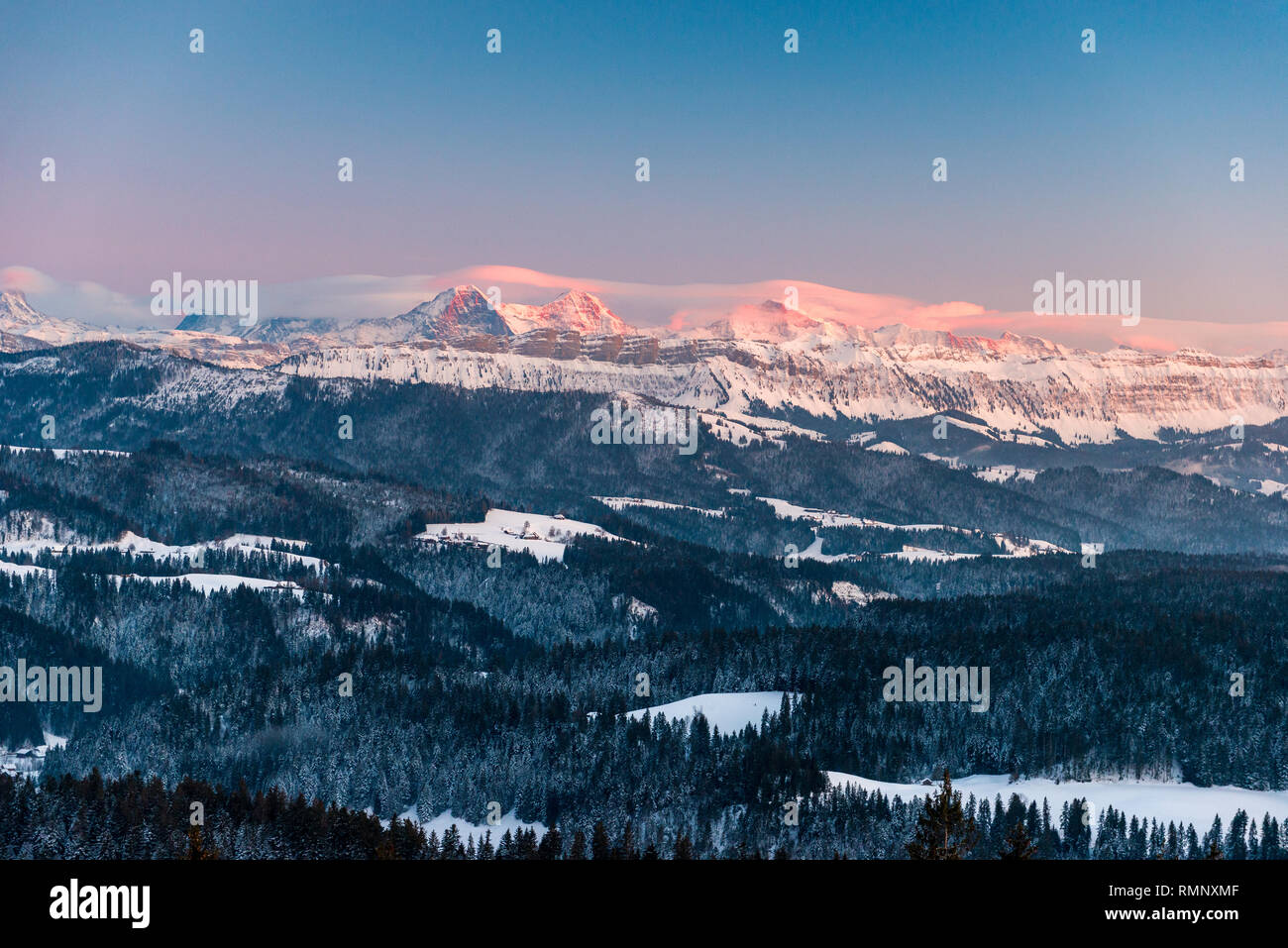 Alpenglow in winter on Eiger Mönch and Jungfrau in the Bernese Alps - Stock Image