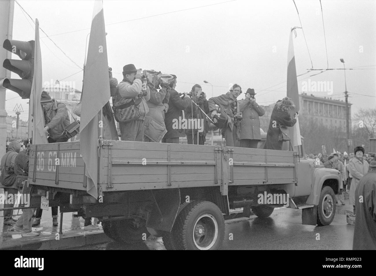 Moscow, USSR - November 7, 1990: Photographers and cameramen shooting on the truck at rally set by Moscow Association of voters, Democratic Russia movement and Democratic Platform without CPSU. - Stock Image