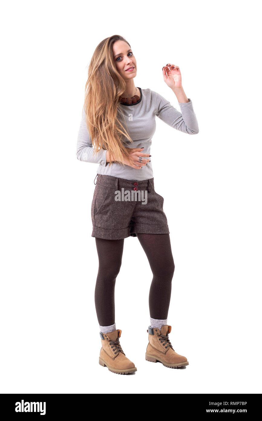 Cute blonde long haired young hipster woman in stylish second hand clothes. Full body isolated on white background. - Stock Image