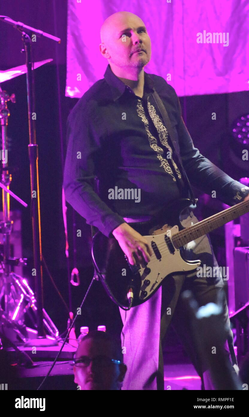 Musician Billy Corgan is shown performing on stage during a 'live' concert appearance with The Smashing Pumpkins. - Stock Image