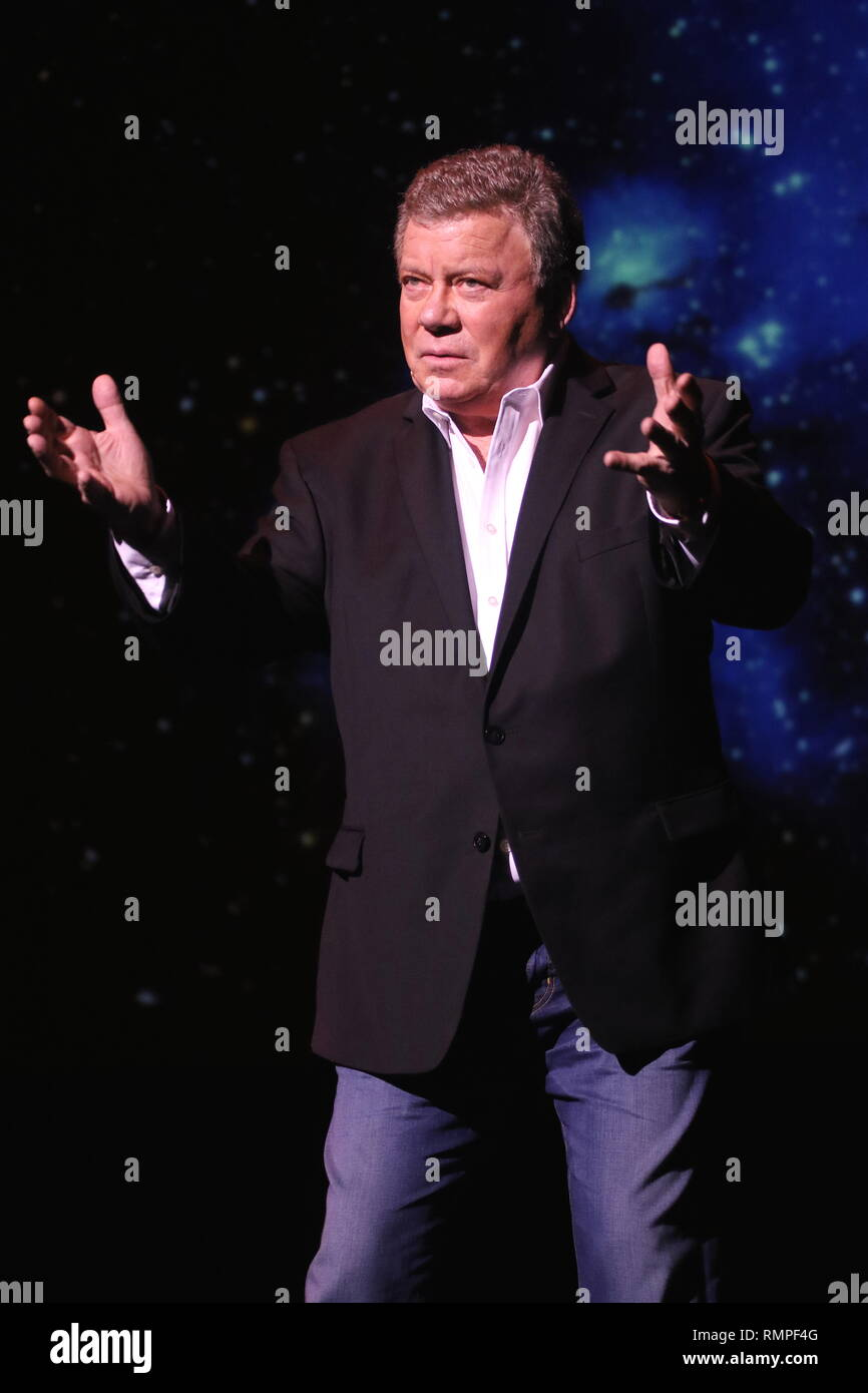 Actor, singer, author, producer, spokesman and comedian William Shatner is shown performing on stage during a stand up concert appearance. - Stock Image