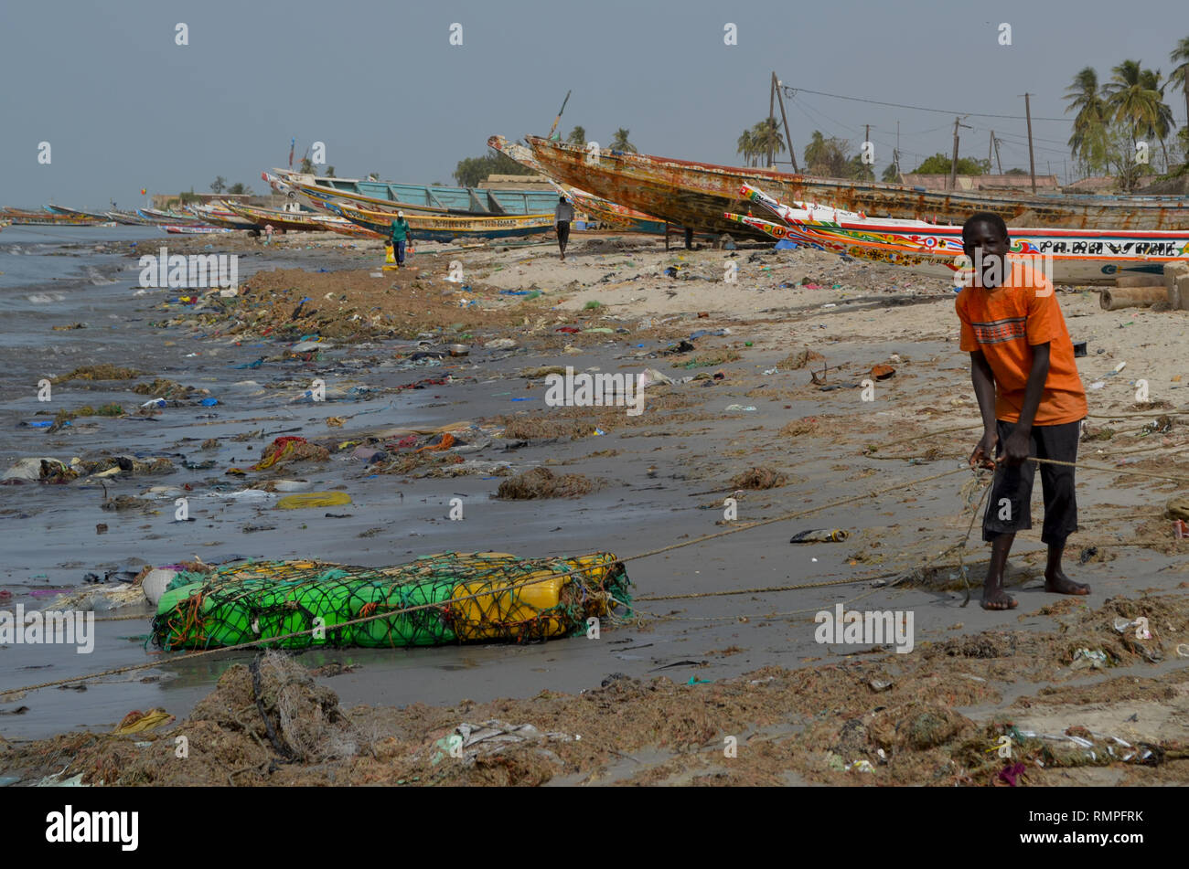 A beach full of plastic litter in the Petite Côte of Senegal, Western Africa - Stock Image