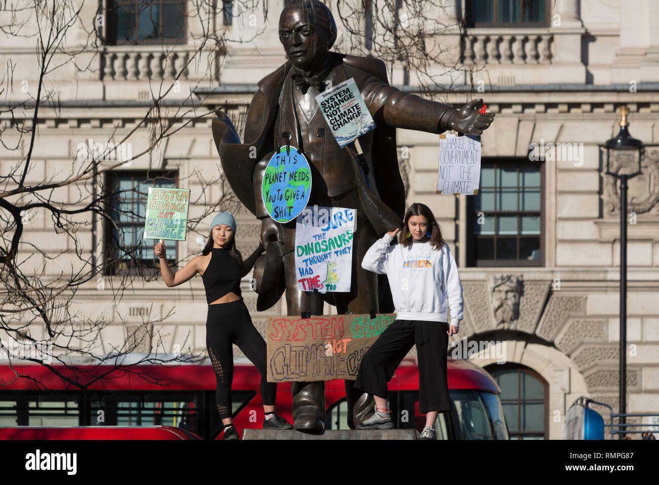 London, UK. 15th Feb, 2019.  Inspired by Swedish teenager Greta Thunberg and organised by Youth Strike 4 Climate, British eco-aware school and college-age pupils protest about Climate Change stand on the statue of Winston Churchill in Parliament Square during their walkout from classes, on 15th February 2019, in Westminster, London England. Photo by Richard Baker / Alamy Live News Credit: RichardBaker/Alamy Live News Stock Photo