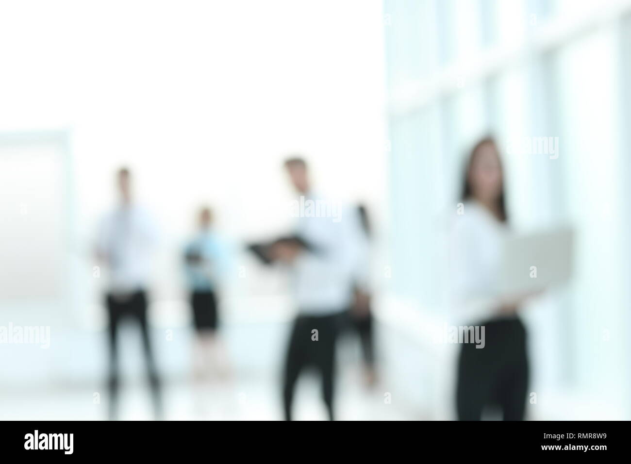 background image of employees standing in the office lobby - Stock Image