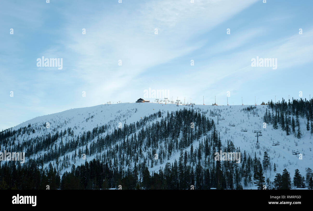 SWEDEN, Skiing can be a means of transport, a recreational activity or a competitive winter sport in which the participant uses skis to glide on snow. - Stock Image