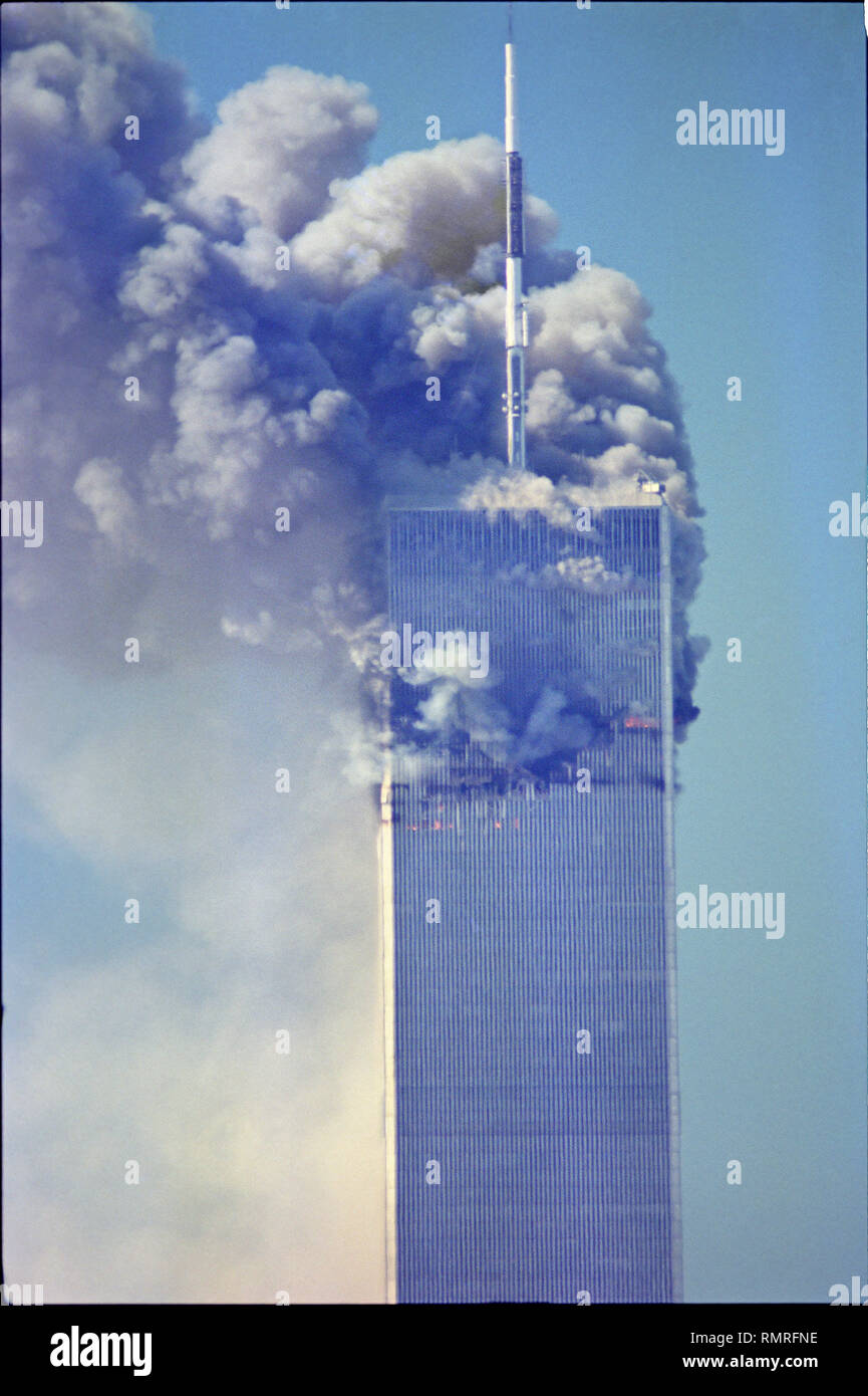 World Trade Center Attack photos taken from 14 street on a rooftop as the towers burn. - Stock Image