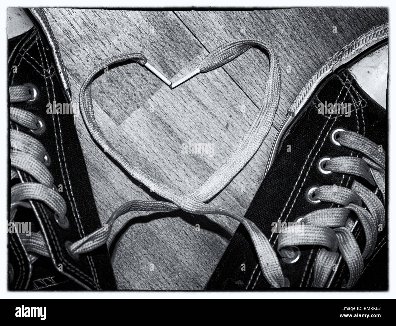 cead9794cbba black and white image of converse trainers shoes with the laces making a  heart shape
