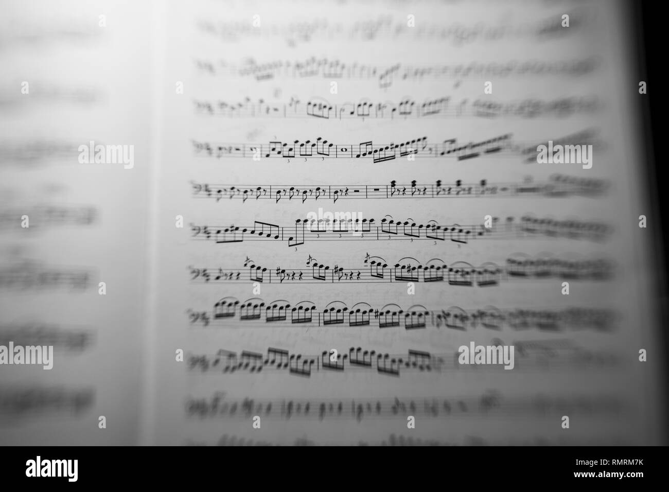 Sheet music for classical music with focus on center frame to convey concept of intensity or focus - Stock Image