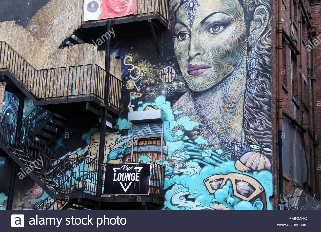 Property in the Northern Quarter of Manchester City Centre with iconic street art by Subism - Stock Image