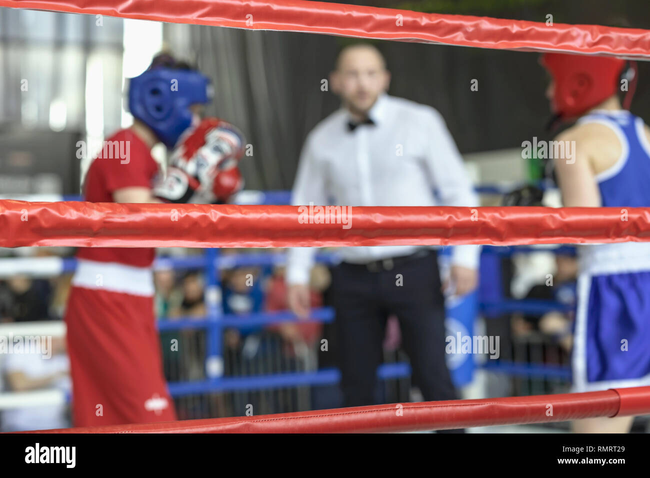 Blurred image young athletes boxers and sports referee in a ring boxing game - Stock Image