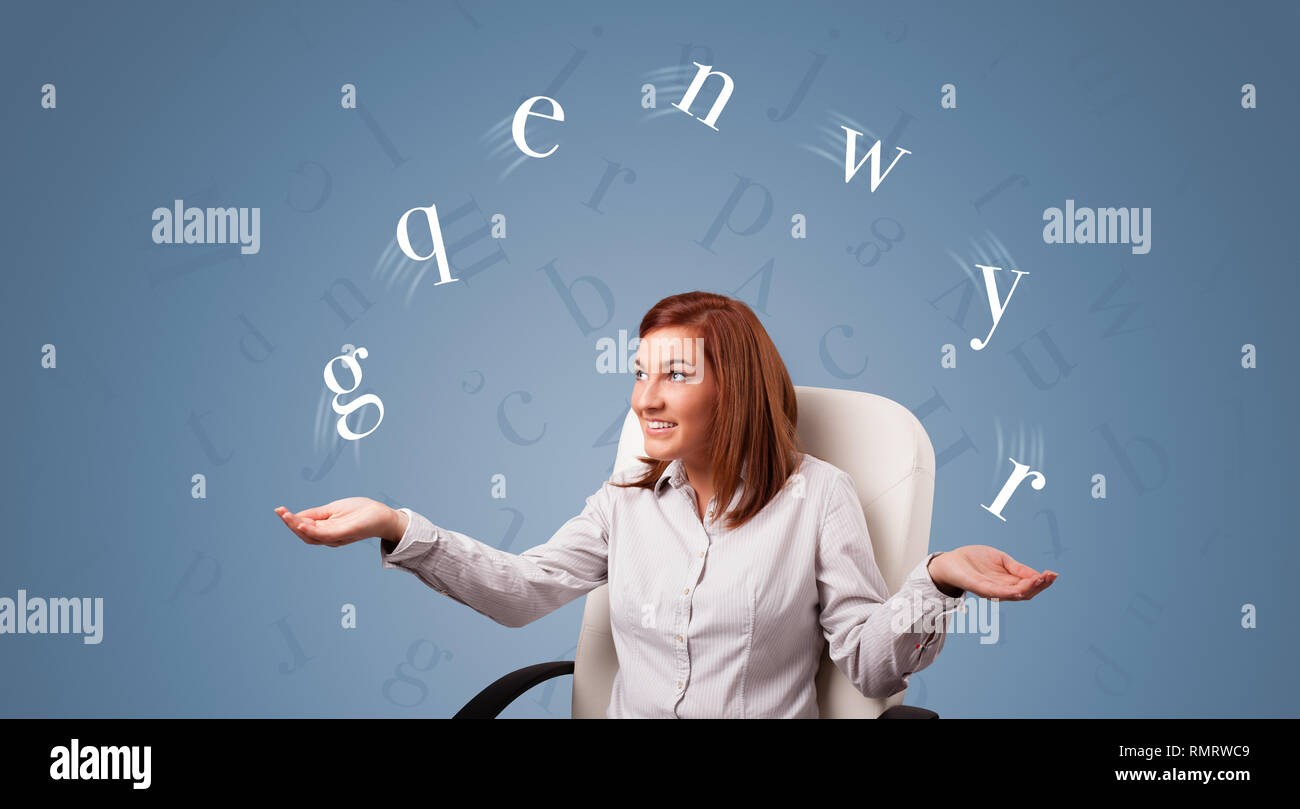 Young student juggle with letters   - Stock Image