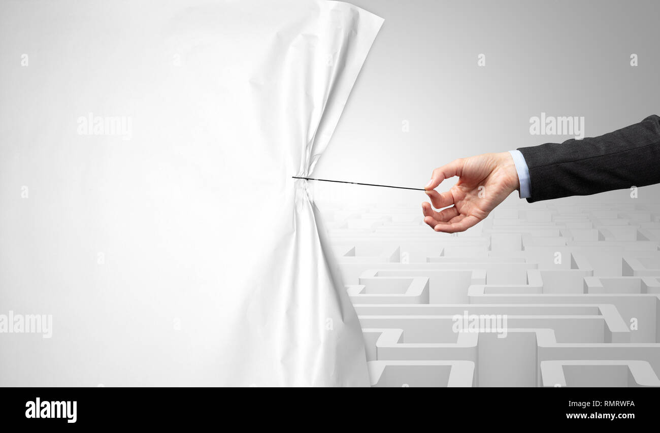 Hand pulling paper curtain, changing scene concept - Stock Image