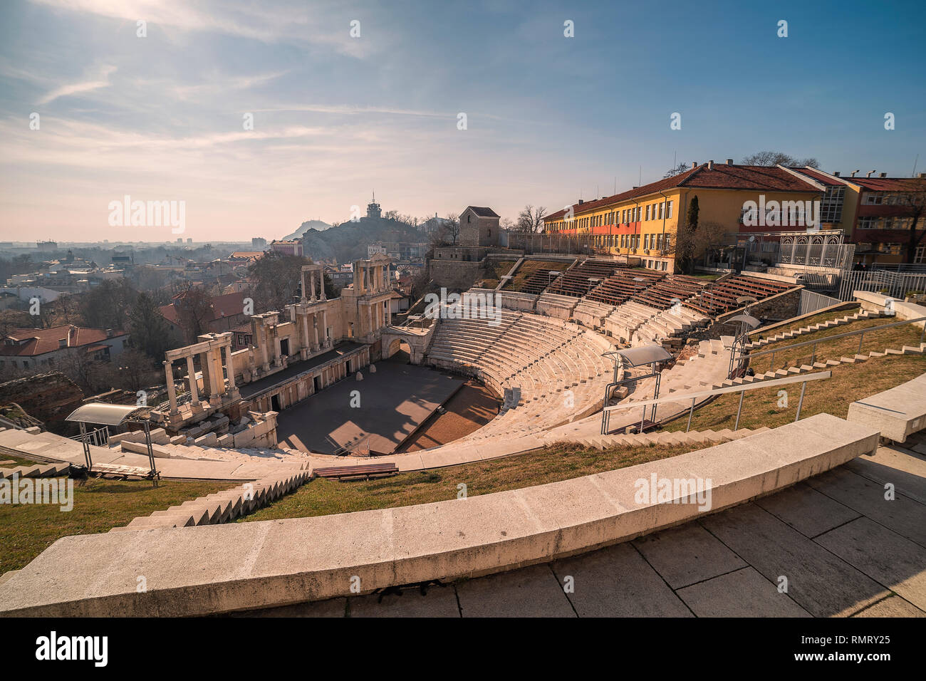 Sunset over ancient roman amphitheater in Plovdiv - european capital of culture 2019, Bulgaria. The old town is included in UNESCO World Herritage - Stock Image