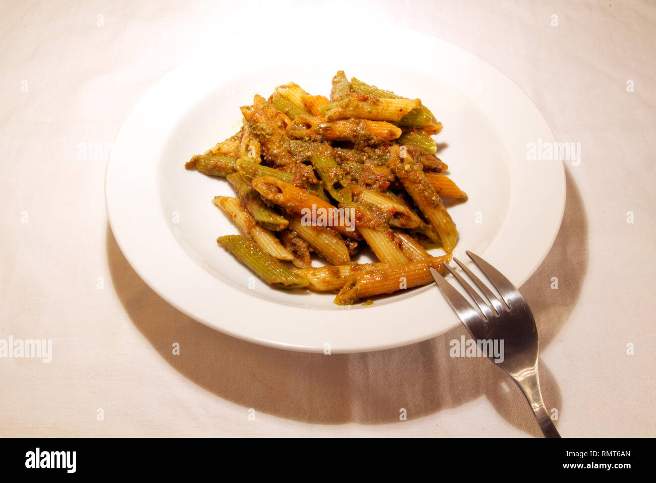 Dubai-Penne pasta cooked with sauce served on a white plate 1 - Stock Image