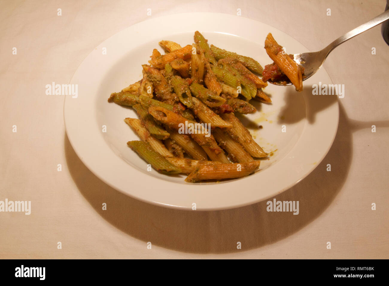 Dubai-Penne pasta cooked with sauce served on a white plate 9 - Stock Image