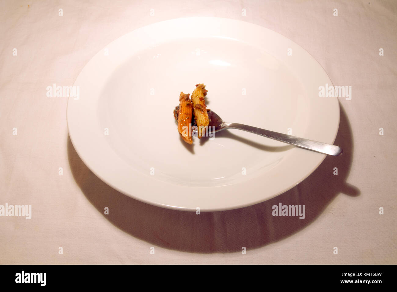 Dubai-Penne pasta cooked with sauce served on a white plate 11 - Stock Image