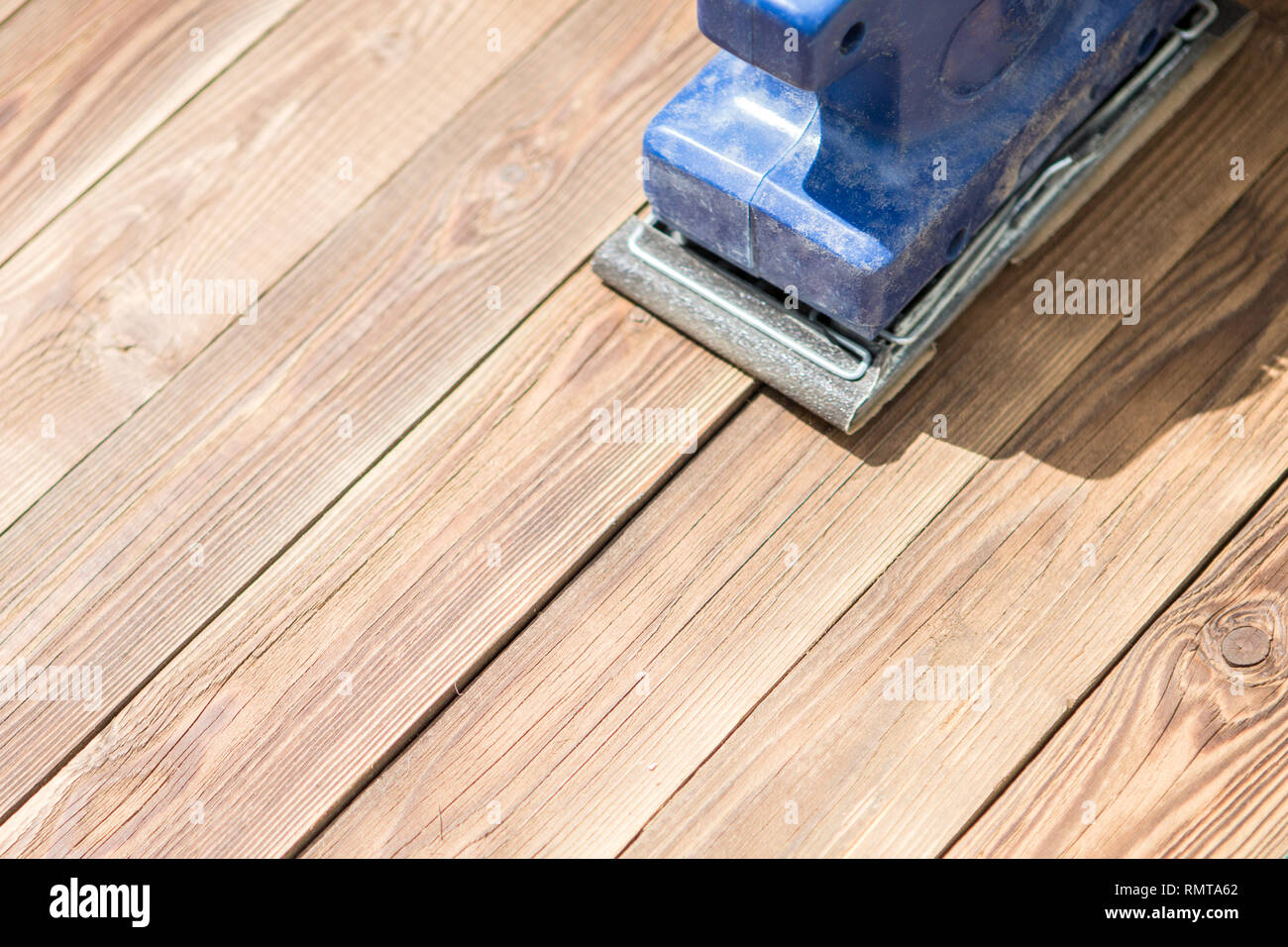 Wooden floor and blue grinder - Stock Image