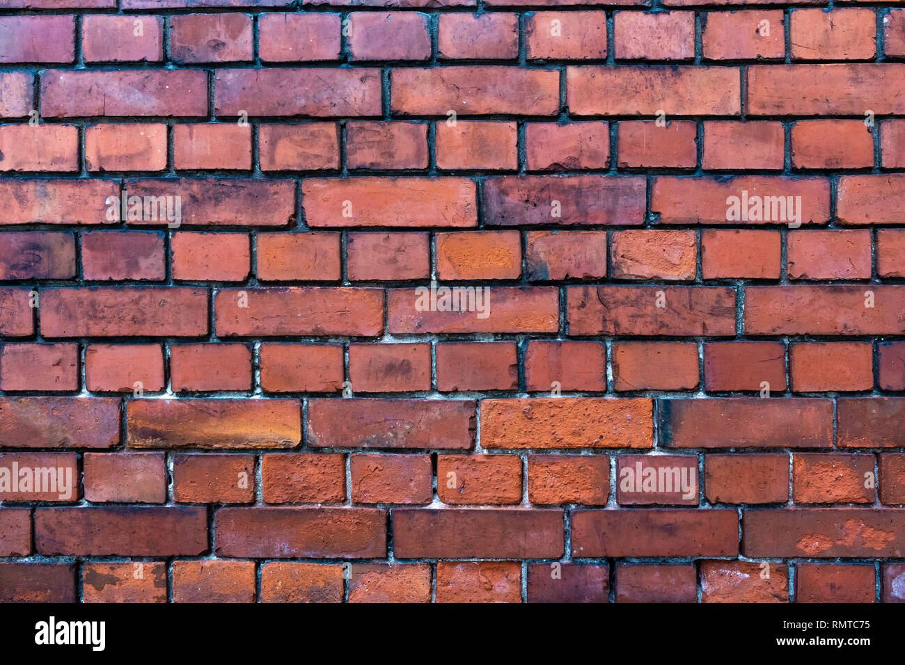 Front close-up view of a old brick wall. - Stock Image