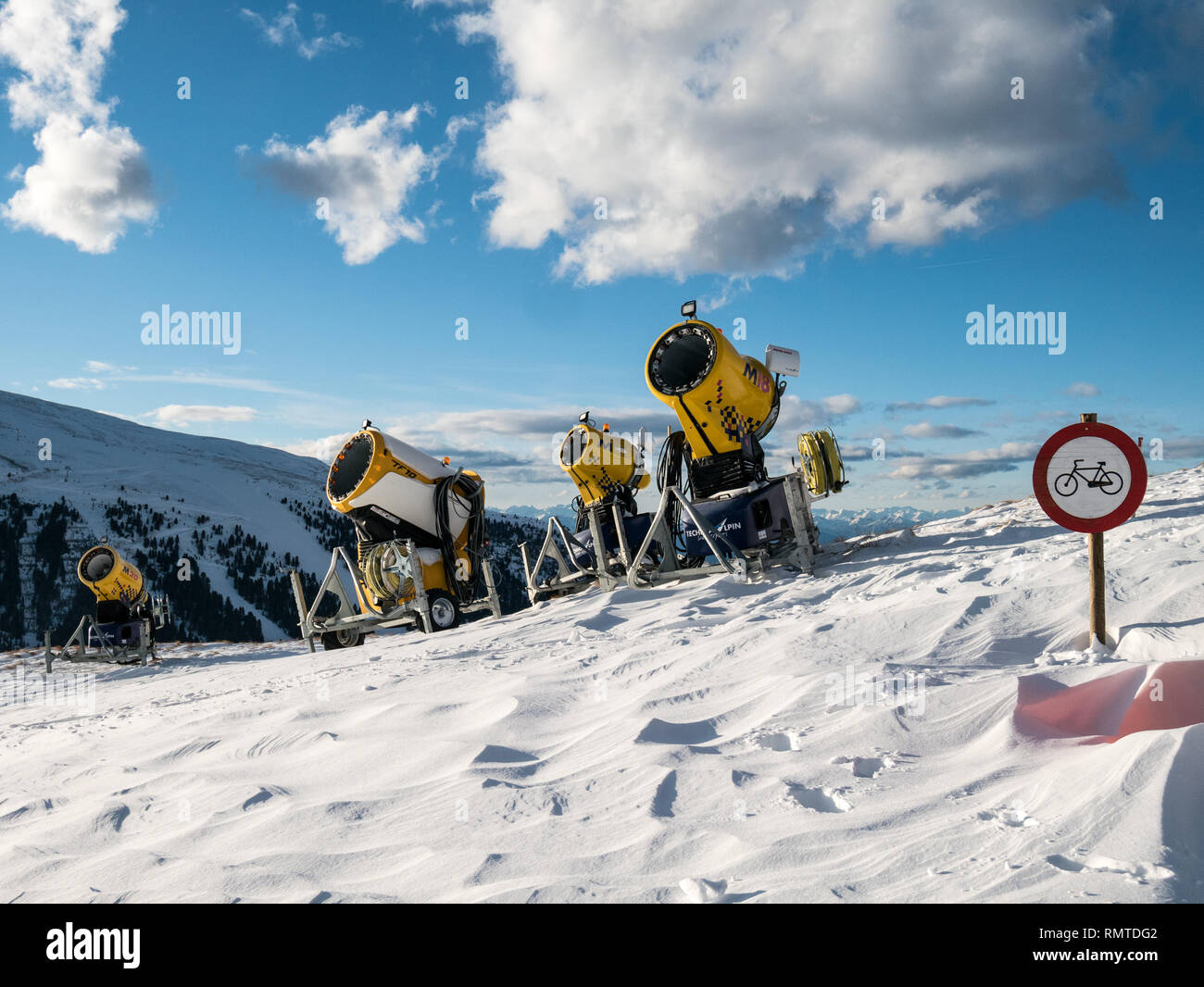 Snow cannons and 'no cycling' sign on Passo Feudo, Dolomiti, Italy - Stock Image