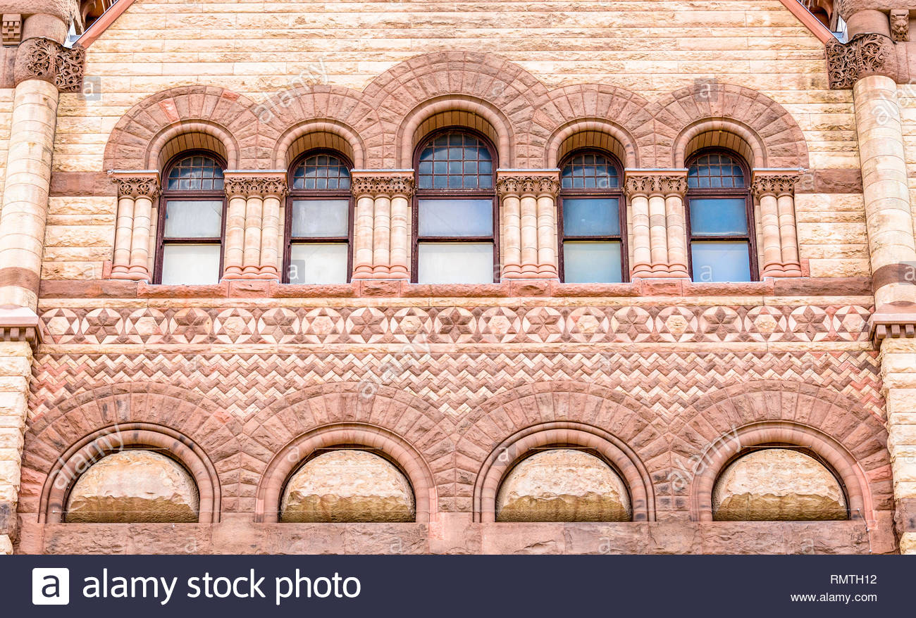 Toronto, Canada, architectural details of the Old City Hall which is a variance of the Romanesque Revival called Richardsonian Romanesque. - Stock Image