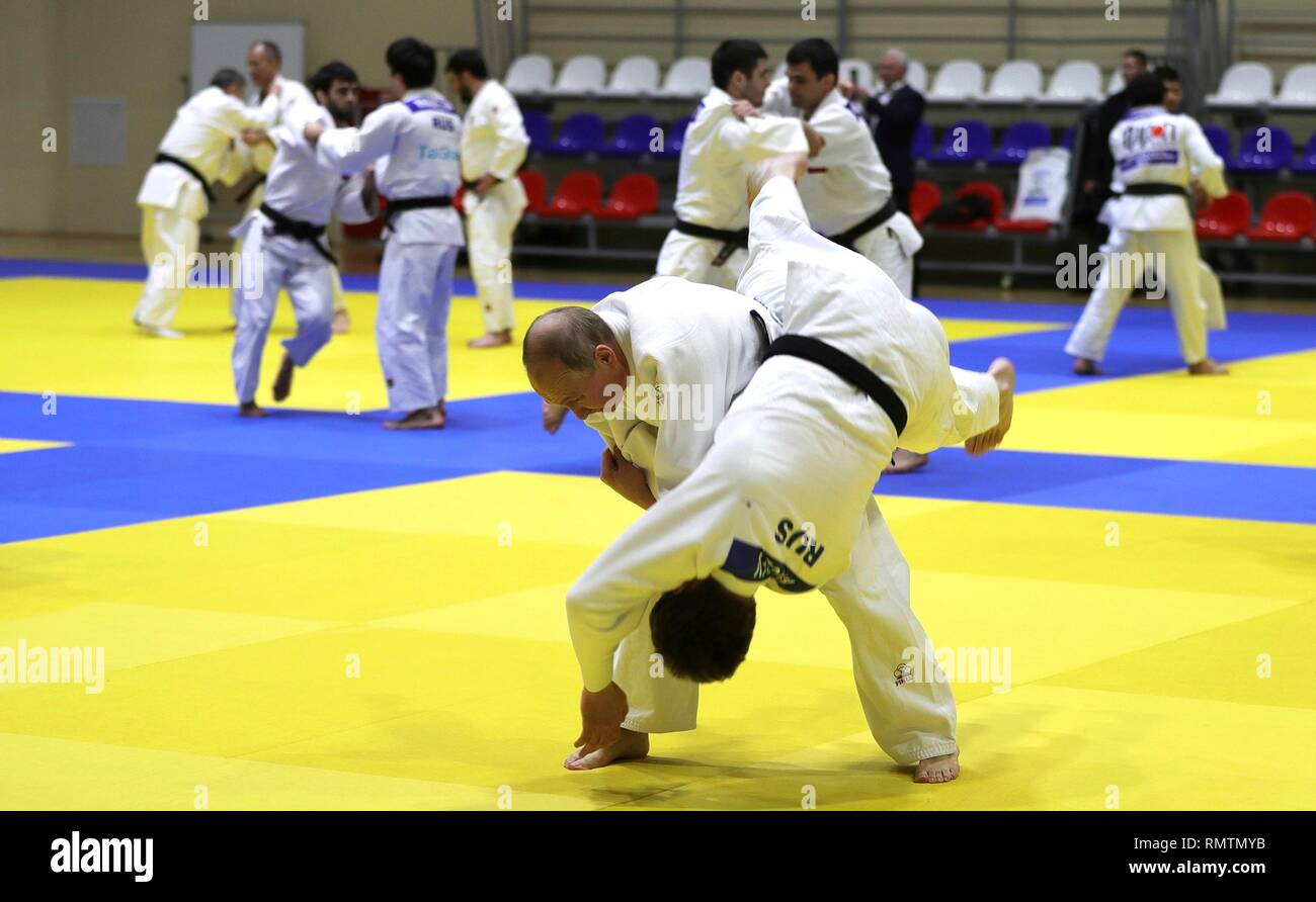 Russian President Vladimir Putin spars during judo practice with the Russian judo team during a visit to the Yug-Sport Training Centre February 14, 2019 in Sochi, Russia. - Stock Image