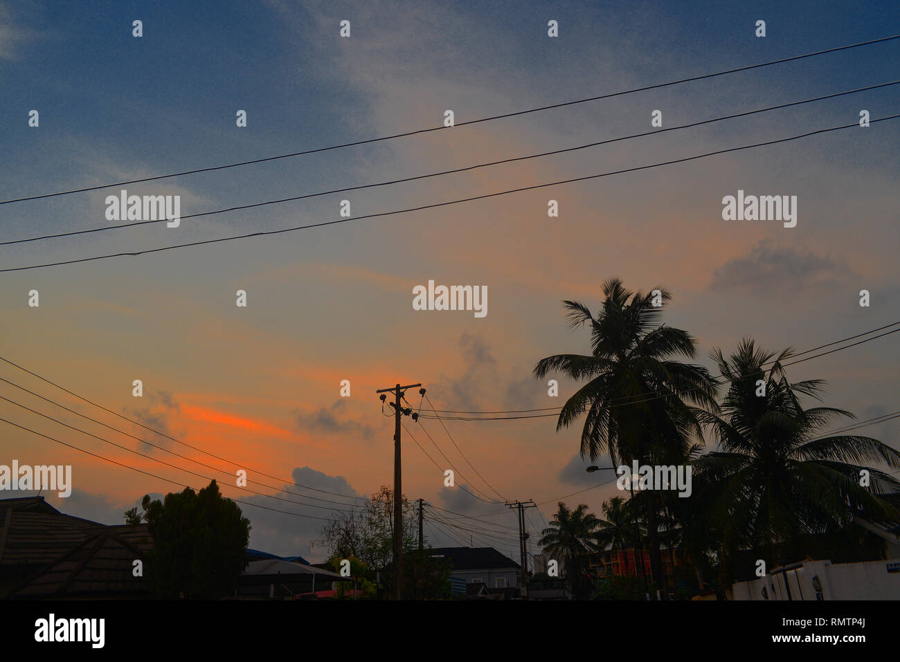 A Lagos Twilight with Electricity Poles and Wires - Stock Image