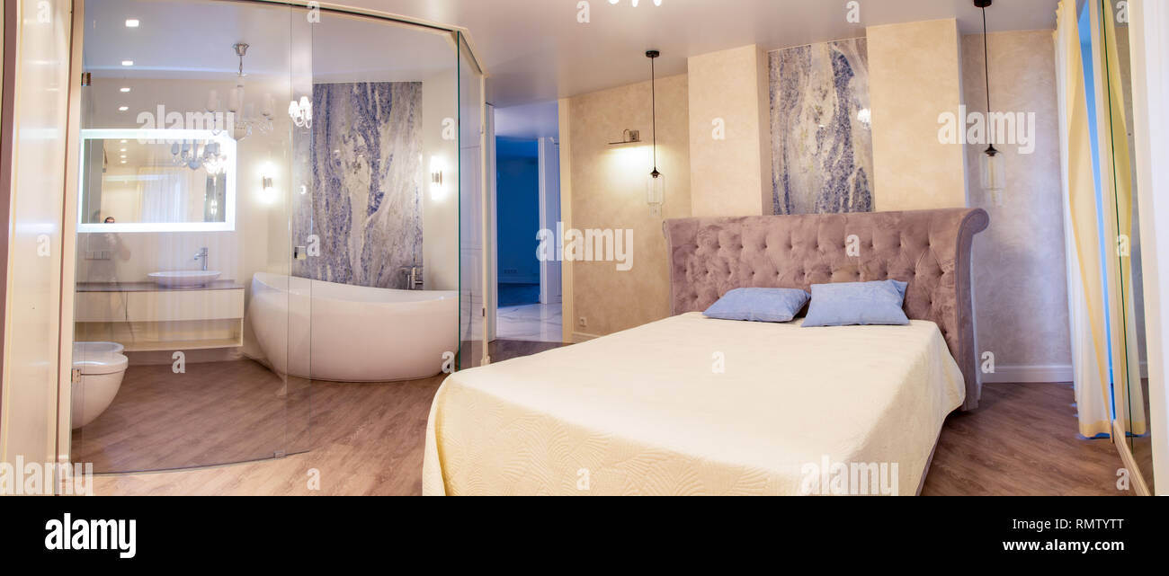 luxary apartment with bedroom and bathroom with glass walls ...