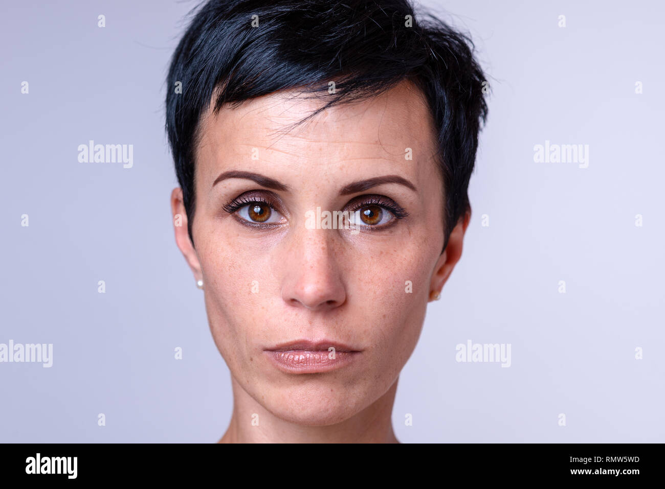 Attractive Woman With A Short Modern Hairstyle And Big Brown