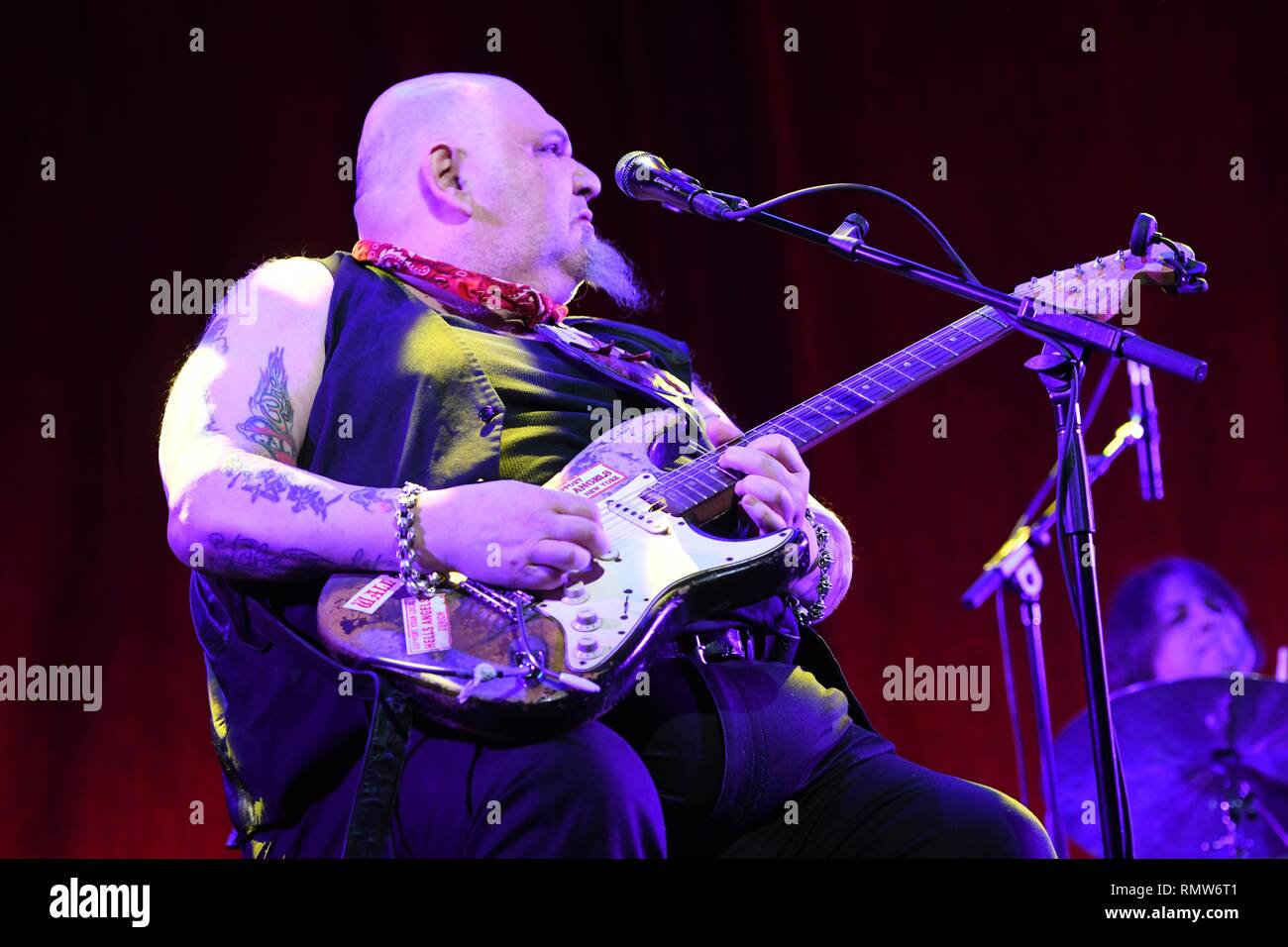 Singer, songwriter and blues guitarist Popa Chubby is shown at the completion of his 'live' concert appearance. - Stock Image
