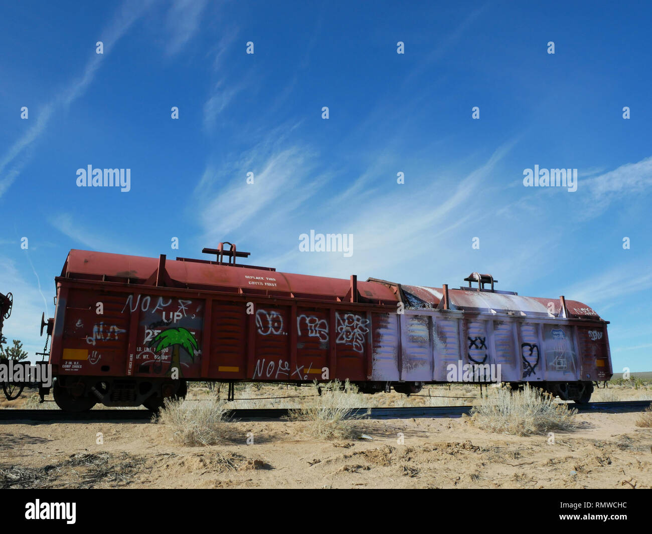Old abandoned railroad car in the California desert - Stock Image