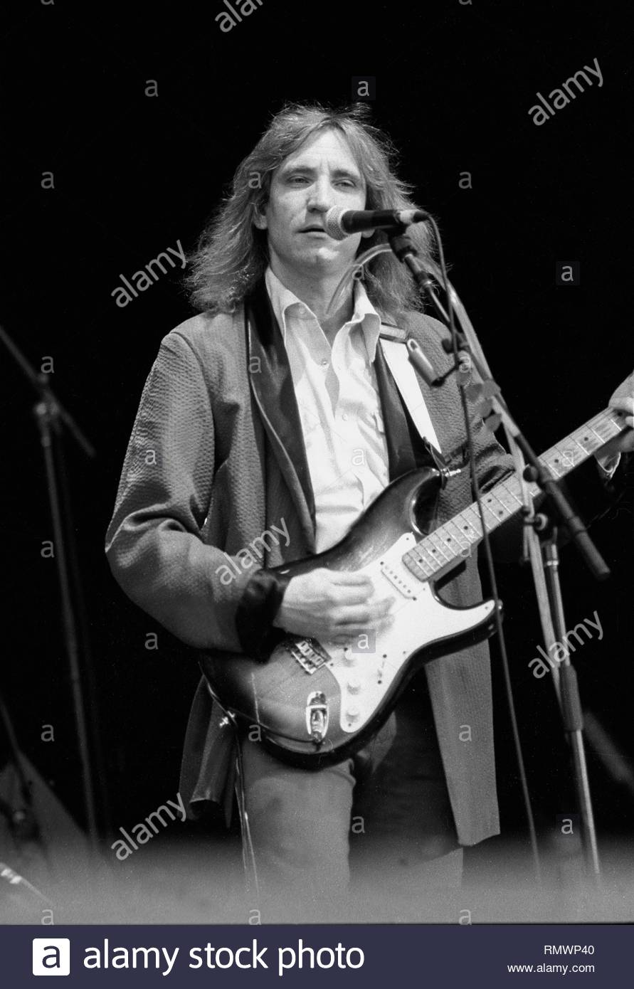 Musician Joe Walsh is shown performing on stage during a 'live' concert appearance Ringo Starr & the All Starr Band. - Stock Image